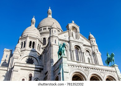 PARIS, FRANCE, on October 30, 2017. The sun lights Sacre-Coeur basilica on a slope of Montmartre being one of city symbols