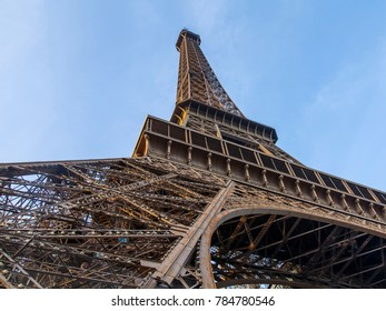 PARIS, FRANCE, on October 30, 2017. The sunset sun lights a fragment of the Eiffel Tower against the background of the sky. This sight is a city symbol