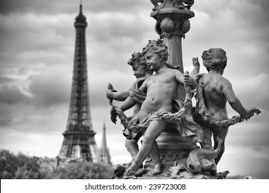 Paris France Pont Alexandre III Bridge statues of cherubs on street lamp with Eiffel Tower in black and white