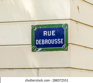 Paris, France - Rue Debrousse old street sign at vintage wall