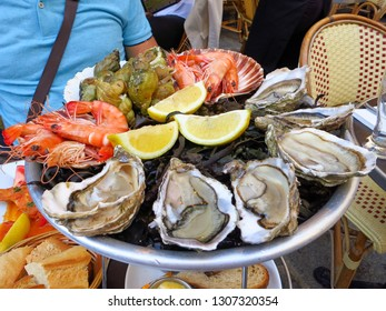 Paris, France: Seafood on a plate of ice with lemon
