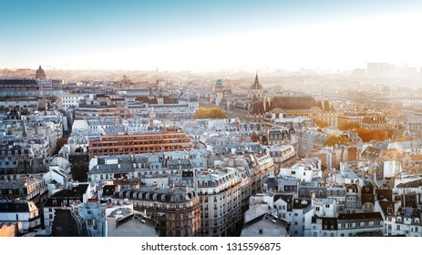 Paris, France - Seine river aerial cityscape in autumn colors. Sorbonne University in the background. Foggy sky with sunlight.