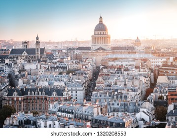 Paris, France - Seine river aerial cityscape in autumn colors. Pantheon building in the background. Foggy sky with sunlight.