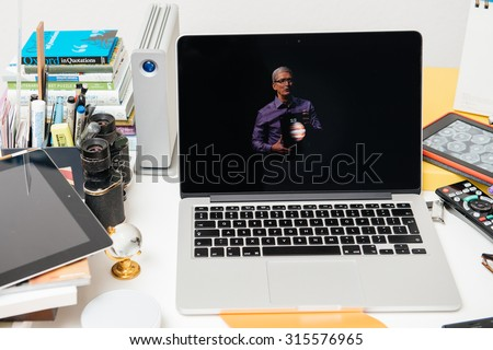 PARIS, FRANCE - SEP 10, 2015: Apple Computers website on MacBook Pro Retina in a creative room environment showcasing Apple Event with Tim Cook holding the new iPad