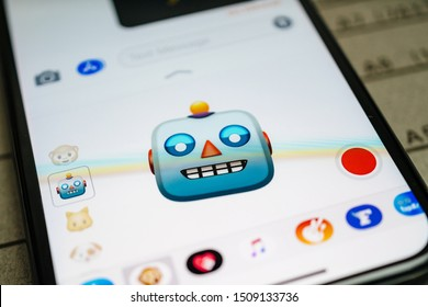 Paris, France - Sep 12, 2019: Latest iPhone 11 Pro featuring multiple Animoji character with face of Robot expressing smiling face sentiments