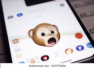 Paris, France - Sep 12, 2019: Latest iPhone 11 Pro featuring multiple Animoji character with face of monkey expressing astonishing face sentiments