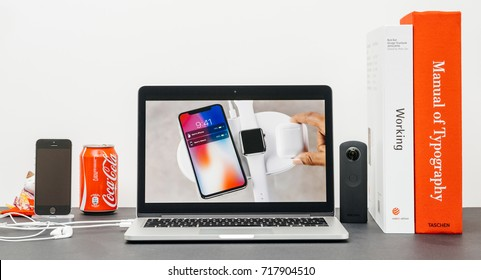 PARIS, FRANCE - SEP 13, 2017: Minimalist creative room and Safari Browser on MacBook Pro laptop showcasing Apple Keynote website presenting the new iPhone X 10 AirCharger wireless charging