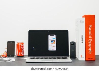 PARIS, FRANCE - SEP 13, 2017: Minimalist creative room and Safari Browser on MacBook Pro laptop showcasing Apple Keynote website with  presenting the new iPhone X 10 emoji with Tim Cook