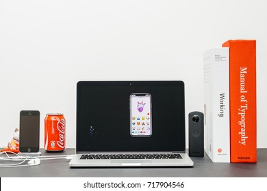 PARIS, FRANCE - SEP 13, 2017: Minimalist creative room and Safari Browser on MacBook Pro laptop showcasing Apple Keynote website with Craig Federighi  presenting the new iPhone X 10 unicorn animoji