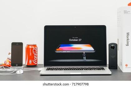 PARIS, FRANCE - SEP 13, 2017: Minimalist creative room and Safari Browser on MacBook Pro laptop Apple Keynote website  Phil Schiller Apple marketing chief presenting iPhone X 10 preorder october date