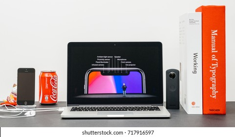 PARIS, FRANCE - SEP 13, 2017: Minimalist creative room and Safari Browser on MacBook Pro laptop  Apple Keynote website with Phil Schiller presenting the new iPhone X 10 sensors on TrueDepth Camera