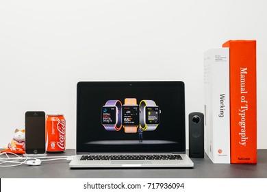 PARIS, FRANCE - SEP 13, 2017: Minimalist creative room  Safari Browser open on MacBook Pro laptop showcasing Apple Keynote website - Jeff Williams presenting the Apple Watch 3 health and sport app