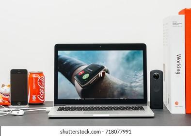 PARIS, FRANCE - SEP 13, 2017: Minimalist creative room  Safari Browser open on MacBook Pro laptop Apple Keynote website - Apple COO Jeff Williams presenting the Apple Watch 3 swim, waterproof watch
