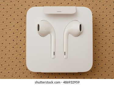 PARIS, FRANCE - SEP 16 2016: New Apple iPhone 7 Plus unboxing in the first day of sales - New Apple Earpods Airpods in box. New Apple iPhone acclaims to become the most popular smart phone