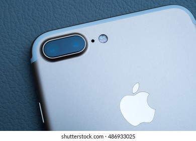 PARIS, FRANCE - SEP 16 2016: New Apple iPhone 7 Plus unboxing in the first day of sales - two camera lens rear view on colorful background. New Apple iPhone acclaims to become the most popular phone