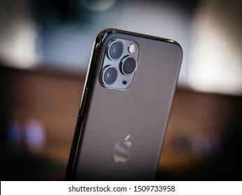 Paris, France - Sep 20, 2019: Close-up of the rear view of the new iPhone 11 Pro Pro Max with triple-camera in Apple Store on the day smartphone by Apple Computers goes on sale