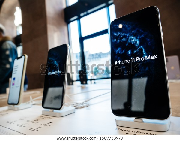 Paris, France - Sep 20, 2019: Low wide-angle of the new iPhone 11, 11 Pro and Pro Max are displayed as the smartphone by Apple Computers goes on sale - demo wallpaper