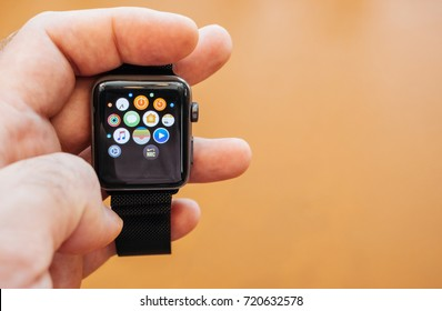 PARIS, FRANCE - SEP 22, 2017: New Apple Watch Series 3 goes on sale in Apple Store with hand holding the app with home screen