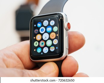 PARIS, FRANCE - SEP 22, 2017: New Apple Watch Series 3 goes on sale in Apple Store with male customer holding the face watch with home screen all apps