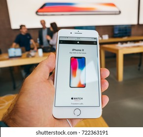 PARIS, FRANCE - SEP 22, 2017: New iPhone 8 and iPhone 8 Plus, as well the updated Apple Watch, Apple TV goes on sale today in Apple Store with customer POV at iPhone X site