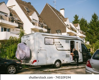 PARIS, FRANCE - SEP 24, 2017: Man boarding an HYMER RV travel trailer in preparation for holidays