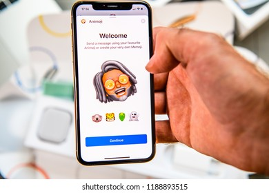 PARIS, FRANCE - SEP 24, 2018: Unboxing of iPhone Xs Max with demonstration of Messaging App with new Animoji Memoji features characters - augmented reality communication create very own - senior man