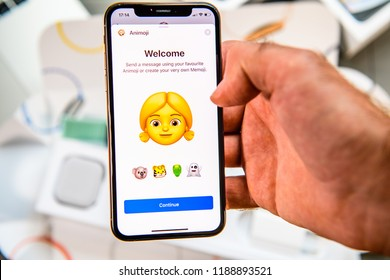 PARIS, FRANCE - SEP 24, 2018: Unboxing of iPhone Xs Max with demonstration of Messaging App with new Animoji Memoji features characters - augmented reality communication create very own young blonde
