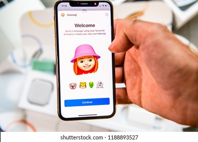 PARIS, FRANCE - SEP 24, 2018: Unboxing of iPhone Xs Max with demonstration of Messaging App with new Animoji Memoji features characters - augmented reality communication create very own yong redhair