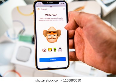 PARIS, FRANCE - SEP 24, 2018: Unboxing of iPhone Xs Max with demonstration of Messaging App with new Animoji Memoji features characters - augmented reality communication create very own - cowboy with