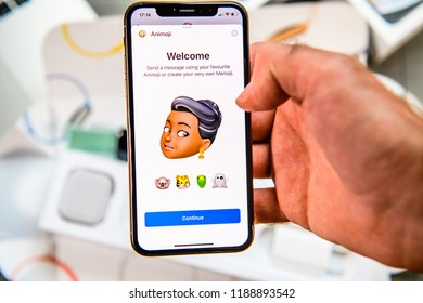 PARIS, FRANCE - SEP 24, 2018: Unboxing of iPhone Xs Max with demonstration of Messaging App with new Animoji Memoji features characters - augmented reality communication create very own black ethncity