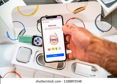 PARIS, FRANCE - SEP 24, 2018: Unboxing of iPhone Xs Max with demonstration of Messaging App with new Animoji Memoji features characters - augmented reality communication create very own