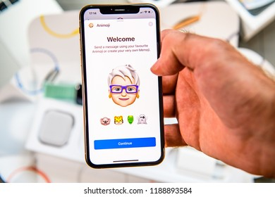 PARIS, FRANCE - SEP 24, 2018: Unboxing of iPhone Xs Max with demonstration of Messaging App with new Animoji Memoji features characters - augmented reality communication create very own senior woiman