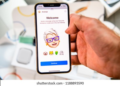 PARIS, FRANCE - SEP 24, 2018: Unboxing of iPhone Xs Max with demonstration of Messaging App with new Animoji Memoji features characters - augmented reality communication create very own smiling senior