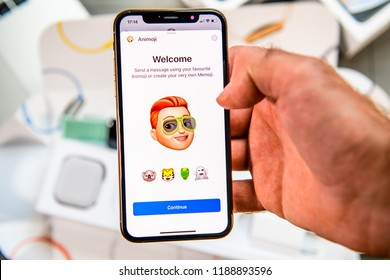 PARIS, FRANCE - SEP 24, 2018: Unboxing of iPhone Xs Max with demonstration of Messaging App with new Animoji Memoji features characters - augmented reality communication create very own man with red