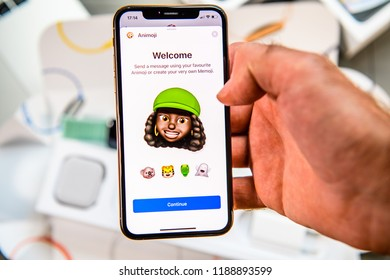 PARIS, FRANCE - SEP 24, 2018: Unboxing of iPhone Xs Max with demonstration of Messaging App with new Animoji Memoji features characters - augmented reality communication create very own black