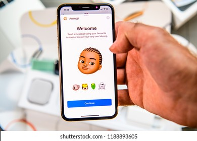 PARIS, FRANCE - SEP 24, 2018: Unboxing of iPhone Xs Max with demonstration of Messaging App with new Animoji Memoji features characters - augmented reality communication create very own young black