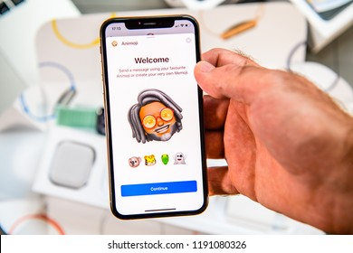 PARIS, FRANCE - SEP 24, 2018: Unboxing of iPhone Xs Max with demonstration of Messaging App with new Animoji Memoji characters - augmented reality communication create very own rastafari young man