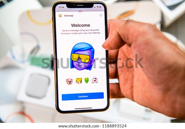 PARIS, FRANCE - SEP 24, 2018: Unboxing of iPhone Xs Max with demonstration of Messaging App with new Animoji Memoji features characters - augmented reality communication create very own trance adult