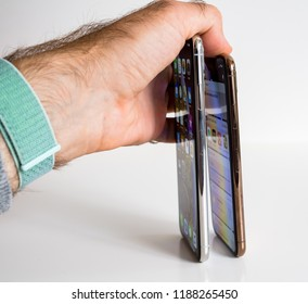 PARIS, FRANCE - SEP 25, 2018: New iPhone Xs and Xs Max smartphone model by Apple Computers close up. Newest golden Apple Iphone 11 mobile phone device on technology background square image