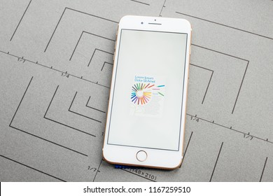 PARIS, FRANCE - SEP 26, 2016: Male hand holding New Apple iPhone 7 8 Plus after unboxing and testing by installing the app application software new Keynote App