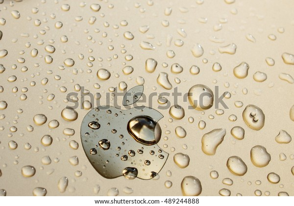 PARIS, FRANCE - SEP 26, 2016: New Apple iPhone 7 Plus unboxing and testing - Apple logo covered with water drops. New iPhone7 is one of the best waterproof smart phone in the world