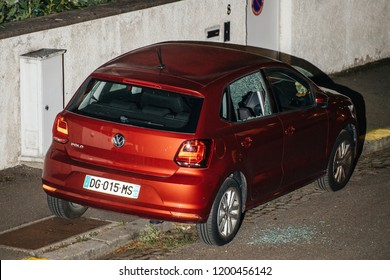 PARIS, FRANCE SEP 26, 2018: new red car with the broken glass window shattered glass on asphalt - robbery, break-in, burglary, embezzlement felony in calm neighborhood