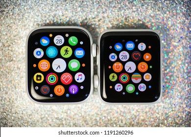 PARIS, FRANCE - SEP 28, 2018: Side by side Apple Watch Series 3 and Apple Watch series 4 wearable smartwatch computers by Apple Computers against sparling holiday background