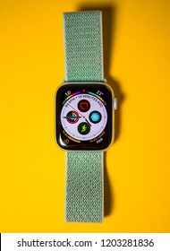PARIS, FRANCE - SEP 28, 2018: New Apple Watch Series 4 last generation with multiple complications on the clock watch face showing heart, temperature, altitude, time etc