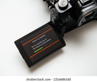 Paris, France Sep 30, 2017: Camera display showing firmware update process on the screen on modern Panasonic Lumix GH5 camera adding new functionalities