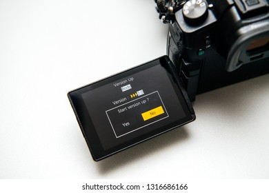 Paris, France Sep 30, 2017: Firmware update process on the screen on modern Panasonic Lumix GH5 camera adding new functionalities - start version up question yes no button