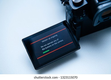 Paris, France Sep 30, 2017: Macro close-up of firmware update process on the screen on modern Panasonic Lumix GH5 camera blue color cast