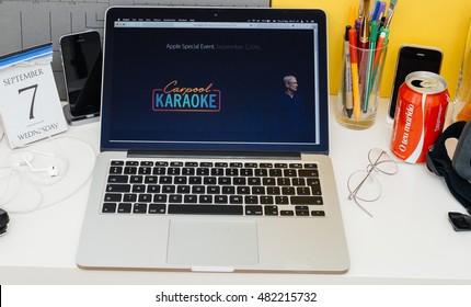 PARIS, FRANCE - SEP 8, 2016: Apple Computers website on MacBook Retina in room environment showcasing live coverage of Apple Keynote - Carpool Karaoke logo and Tim Cooke on stage