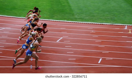 PARIS, FRANCE - SEP.13: Athletes on the start of the 100 meters hurdles race on DecaNation International Outdoor Games on September 13, 2015 in Paris, France.