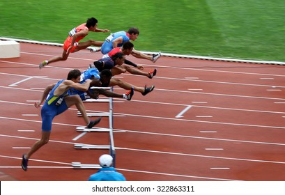PARIS, FRANCE - SEP.13: Athletes on the 110 hurdles race on DecaNation International Outdoor Games on September 13, 2015 in Paris, France.